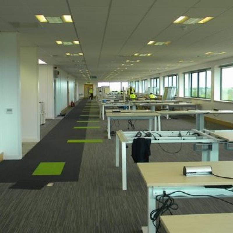 view of open plan office with desks under construction