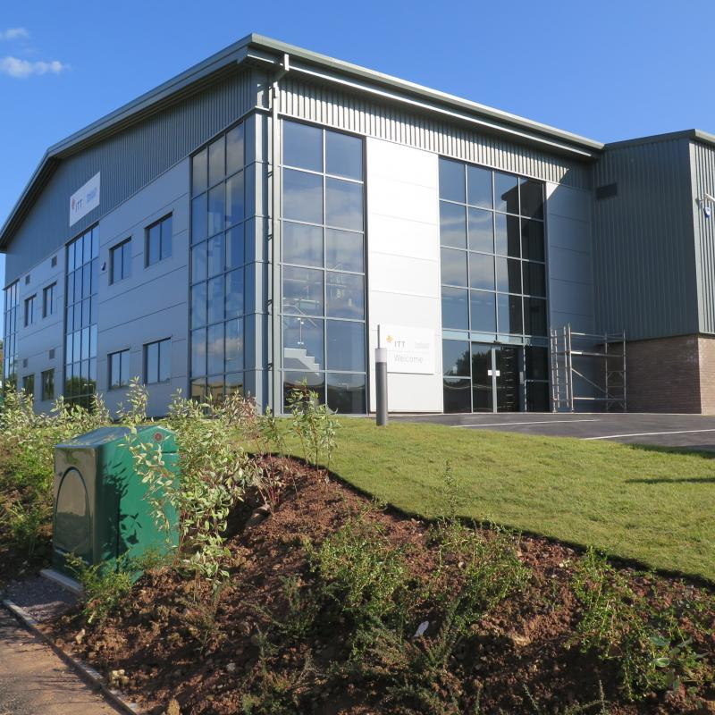 external view of new factory with two storey glazed office end nearest to entrance