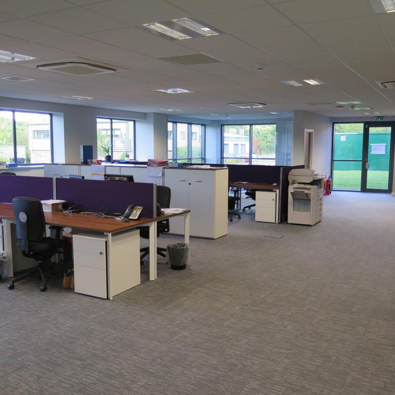 view of ground floor open plan office area with desks