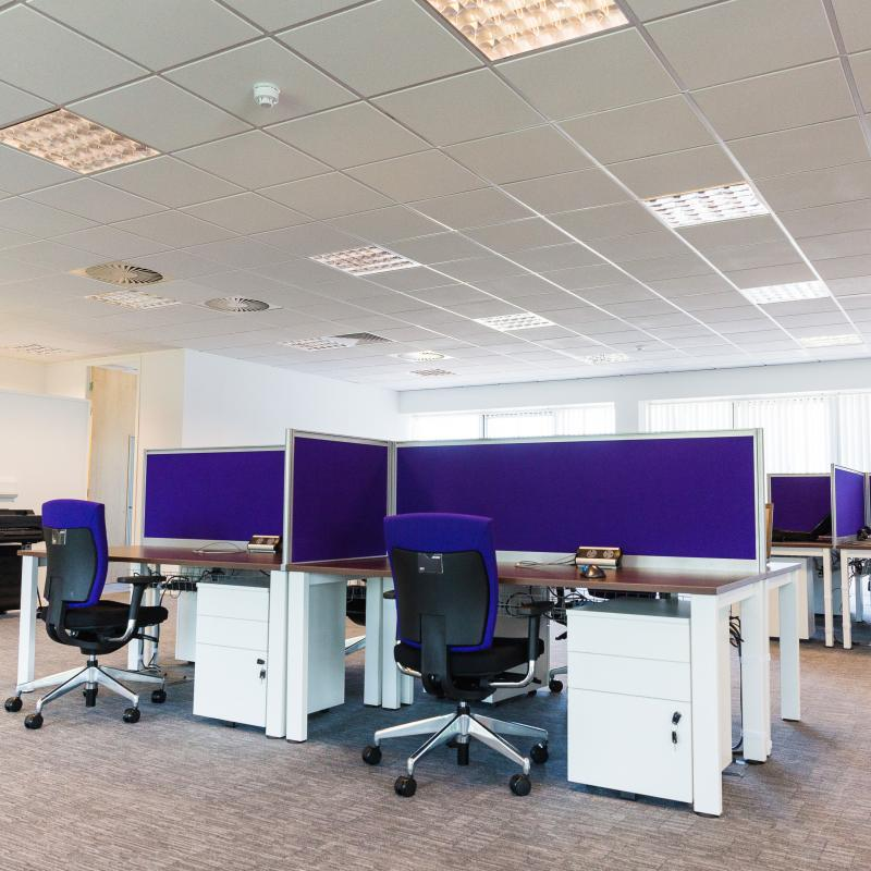 view of open plan desking with tall dividing screens in crucifix layout